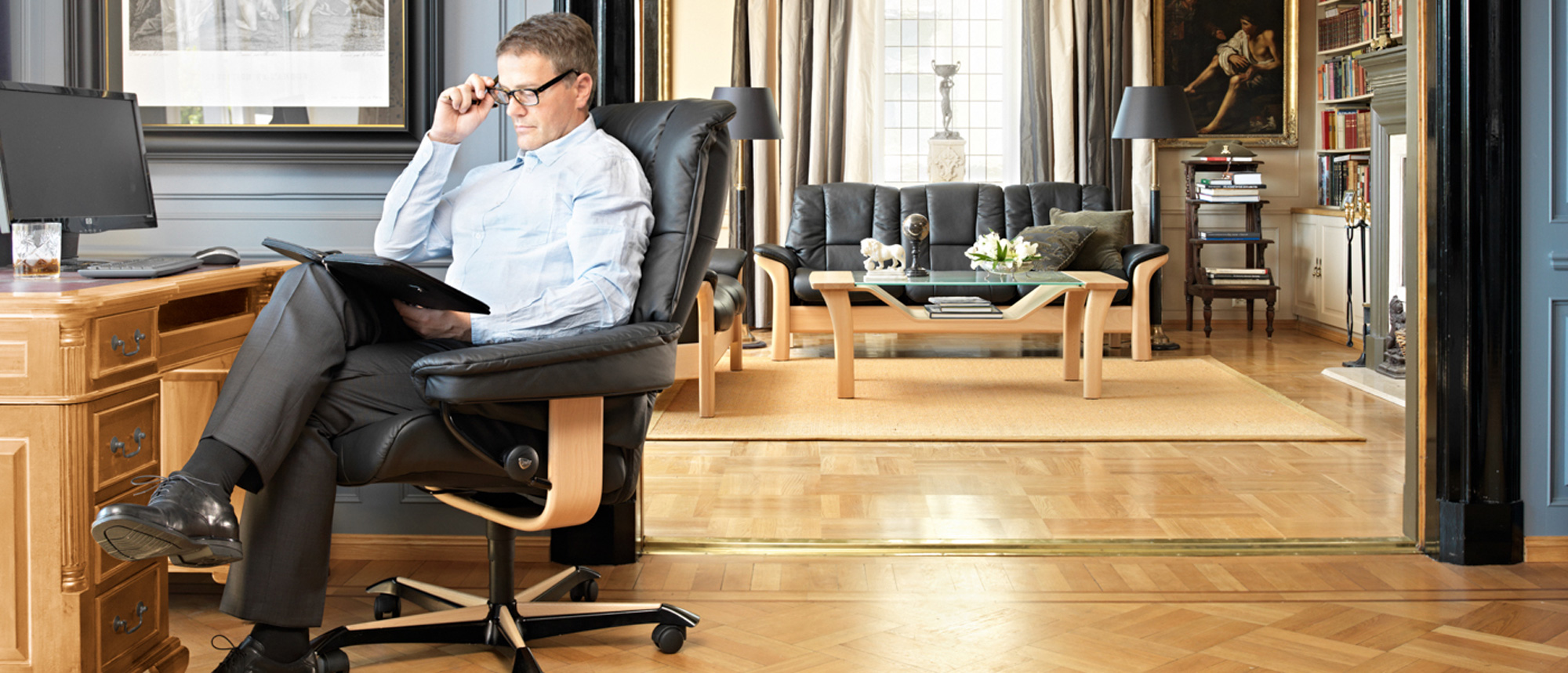 Man sitting in his luxury office furniture.
